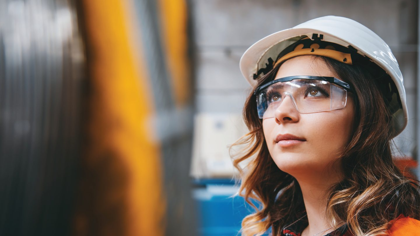 Young female engineer wearing a hard hat